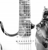 foto of guitar  - guitar player with an open guitar case guitar silhouette in double exposure in black and white - JPG