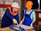 pic of millwright  - Happy old  builder man cutting ceramic tile - JPG