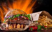stock photo of burger  - Delicious burger with fire flames - JPG