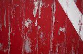stock photo of martha  - Weathered red door with white stripe in Memensha Massachusetts on Martha - JPG