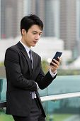 pic of manger  - Asian business check email on smart phone - JPG