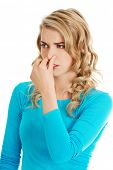 picture of clog  - Portrait of a woman clogging nose - JPG