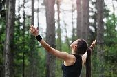stock photo of morning  - healthy lifestyle fitness sporty woman running early in the morning in forest area healthy lifestyle concept