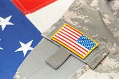 stock photo of chevron  - US army uniform with chevron over flag  - JPG