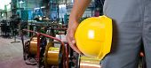picture of workplace safety  - Worker with safety helmet at industrial factory - JPG