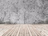 picture of timber  - Empty room with plastered concrete wall and timber flooring - JPG