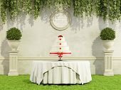 pic of three tier  - Wedding cake on round table in a elegant garden  - JPG
