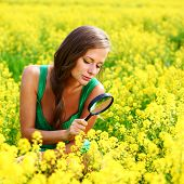botanist woman in yellow flower field