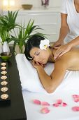 Relaxed beautiful woman having a massage treatment