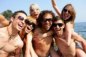 pic of party people  - Group of friends having fun at the beach - JPG