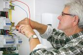 Man working on a circuit breaker