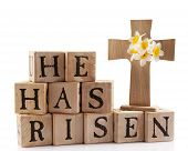 foto of he is risen  - A wooden cross with the words  - JPG