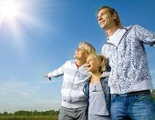 Healthy Family Outdoor.Happy Mother and Father with Kids over blue sky
