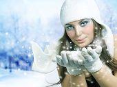 Christmas Girl.Winter Girl Blowing Snow
