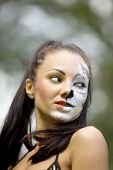 stock photo of tigress  - Girl with tigress make up close up portrait - JPG