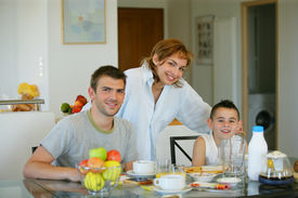 picture of matinee  - Portrait of a smiling family having breakfast - JPG