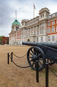 A military trophy -Turkish cannon captured in Egypt in 1801 at Horse Guards Parade with Old Admiralt poster