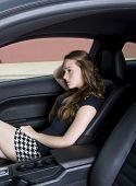 Girl Sitting in Passenger Seat of Car