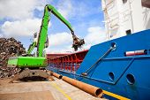 Crane Loading Ship With Steel