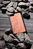 Exclusive Brown Wooden Case For Smartphone.luxury Case. On Stone Background poster