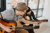 Learning To Play The Guitar. Music Education And Extracurricular Lessons. Hobbies And Enthusiasm For poster
