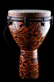 picture of congas  - A complete orange African or Latin Djembe conga drum isolated on black background in the vertical format - JPG