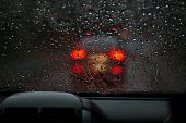 View From A Rain-drenched Windshield On Blurred Back Lights Of A Car In Front. Heavy Rain poster