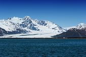 Snowy Alaska mountains by the water