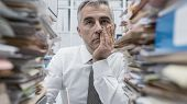 Frustrated Executive Overloaded With Paperwork poster