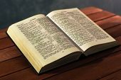 Bible On A Red Wooden Table. Beautiful Background.religion Concept poster