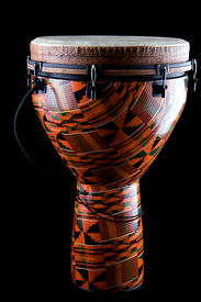 stock photo of congas  - A complete orange African or Latin Djembe conga drum isolated on black background in the vertical format - JPG