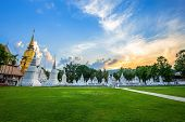 Wat Suan Dok Is A Buddhist Temple (wat) At Sunset Sky Is A Major Tourist Attraction In Chiang Mai,th poster