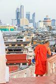 Monk Climbing Down The Stairs Of The Golden Mount, Wat Saket Temple, Bangkok With Bangkok City View  poster