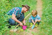 Gardening Hobby. Dad Teaching Little Son Care Plants. Spring Gardening Routine. Planting Flowers. Li poster