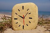 stone clock, game on the beach