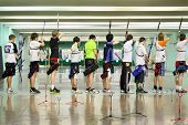 MOSCOW - APRIL 2: Backs of archers at Traditional Archery Championship among adults (undergraduate a