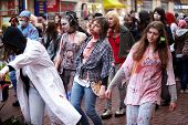 MOSCOW - MAY 14: Unidentified bloodstained female participants of Zombie Parade on Old Arbat, May 14