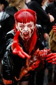 MOSCOW - MAY 14: Unidentified red-haired screaming made-up female participant with bloody face and w