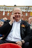 MOSCOW - MAY 9: Gennady Zyuganov talks on cell phone on Victory Day celebration on Red Square, May 9
