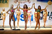MOSCOW - APR 16: V.Komoza, O.Tsariova, A.Kolosova (in front) - winners in bikini category at the Ope