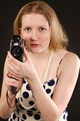 Girl Holding A Vintage Movie Camera