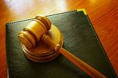 stock photo of court room  - Legal gavel and leather binder on a desk - JPG