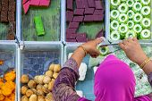 Top View Of Unidentified Vendor At The Food Stall In Kota Kinabalu City Food Market, Sabah, Malaysia poster