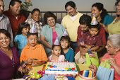 stock photo of niece  - Large Hispanic family celebrating birthday - JPG