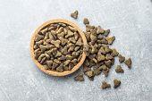 Dry pet food. Kibble dog or cat food in bowl. Top view. poster