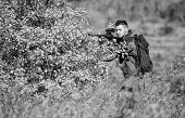 Hunter Hold Rifle. Man Wear Camouflage Clothes Nature Background. Hunting Permit. Hunting Is Brutal  poster