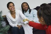 image of nuclear family  - African family exchanging gifts at Christmas - JPG