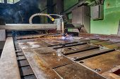 A Plasma Cutting Machine Cuts Large And Thick Steel Sheets. Cnc Equipment For Cutting Large Sheets. poster