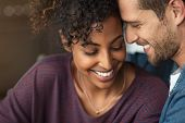 Portrait of attractive couple embracing each other. Closeup loving multiethnic couple embracing and  poster