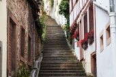 Old Staircase Street With Idyllic Houses In Niederbronn Les Bains In France poster